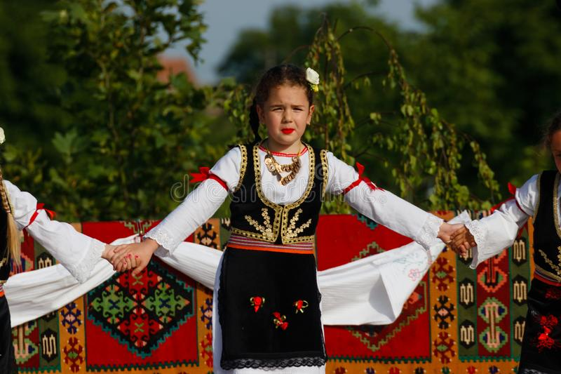 Cute kids with traditional costumes of Vojvodina, Serbia stock photo