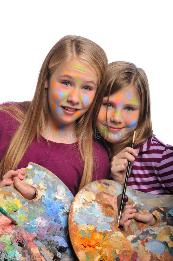 Young Girls doing face paint royalty free stock photo
