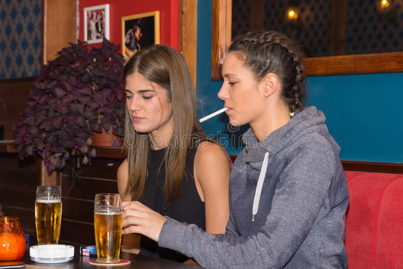 Young girls drinking and having fun together.  stock photos
