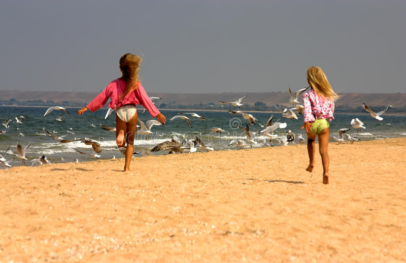 Download Young Girls Happily Running Towards Seagulls Stock Image - Image: 11023843