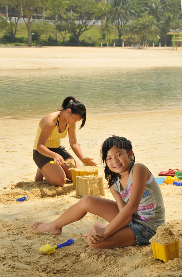 Young Girls Having Fun At The Beach stock photos