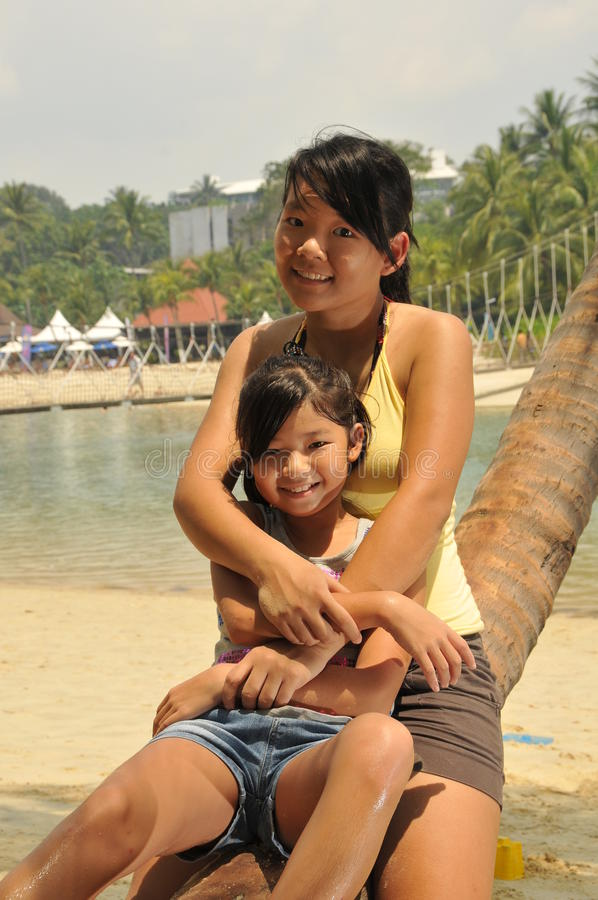 Young Girls Having Fun At The Beach stock photography