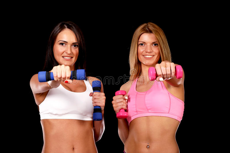 Young girls holding sports weights royalty free stock photography