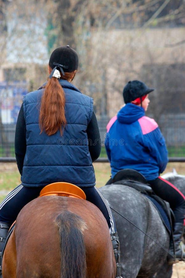 Young girls jockeys stock photo