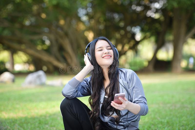 Listen to music smartphones stock image