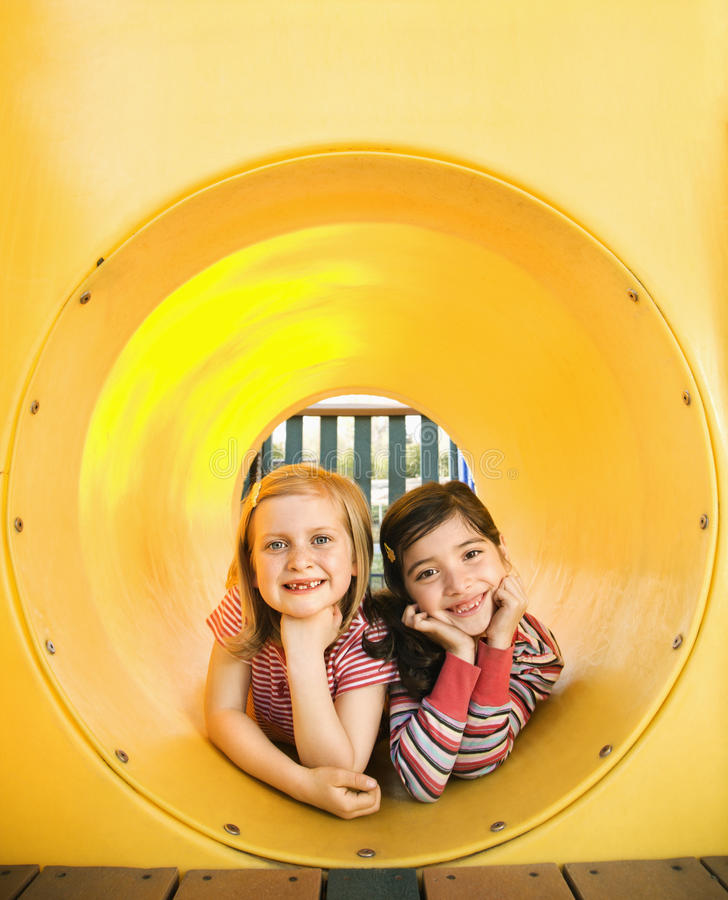 Download Young Girls Lying Together In Crawl Tube Stock Image - Image: 12529025