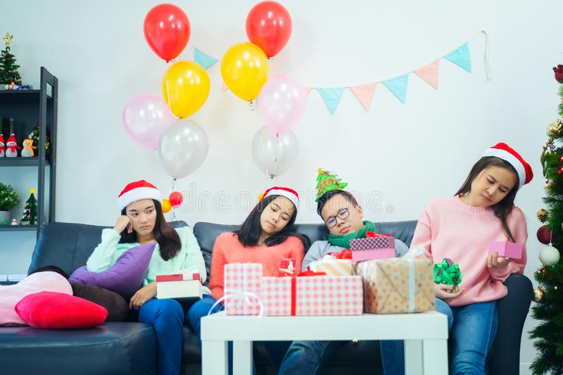 Young girls open gift box day at home feeling displeased. grumpy girls in santa hats buying clothes from christmas sale, jealous. And lonely emotion royalty free stock image
