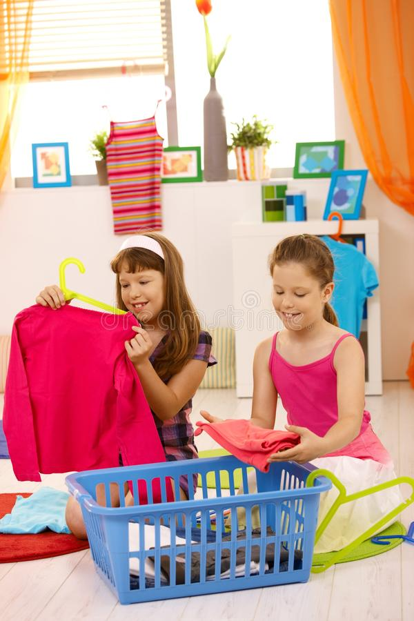 Young girls packing clothes