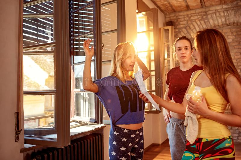Young girls planning choreography of hip hop dancers. Together royalty free stock image