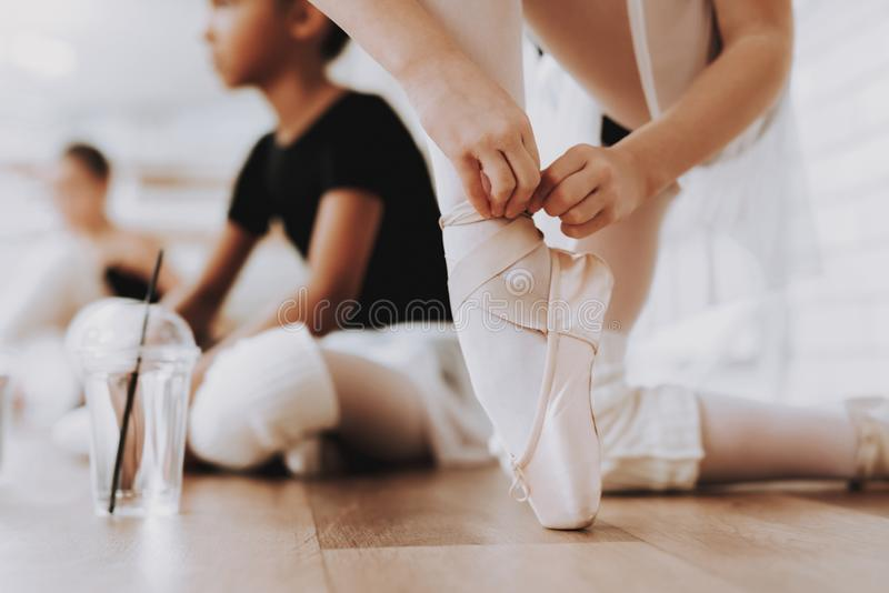 Young Girls Preparing for Ballet Training Indoors. royalty free stock photography