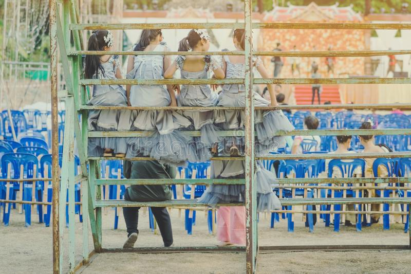 Young girls sit on the grandstand. To wait for the stage performance royalty free stock photos