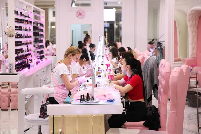Young girls use the service of Express manicure in the salon of. The shopping center. Moscow royalty free stock images