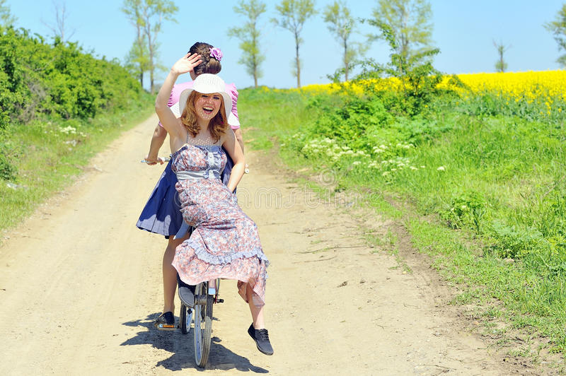 Young girls with a vintage bicycle stock image