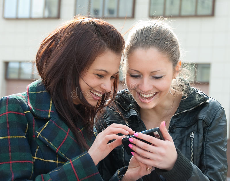 Download Young Girls Watch Something In Mobile Phone Stock Image - Image: 9535059