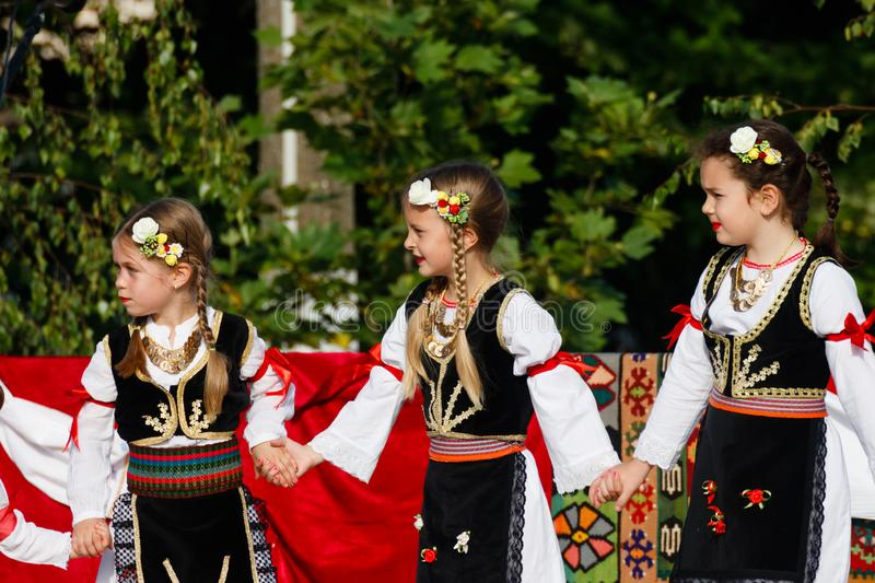 Young girls wearing traditional costumes of Vojvodina, Serbia royalty free stock images