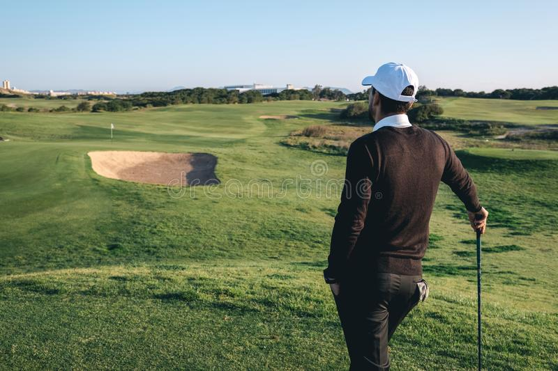 A golf player observes a golf course stock image