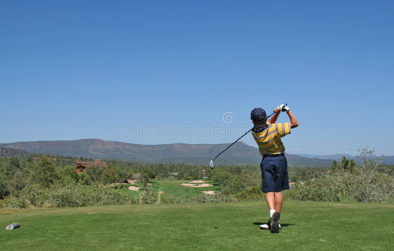 Download Young Golfer Hitting A Golf Shot Stock Image - Image: 1948361