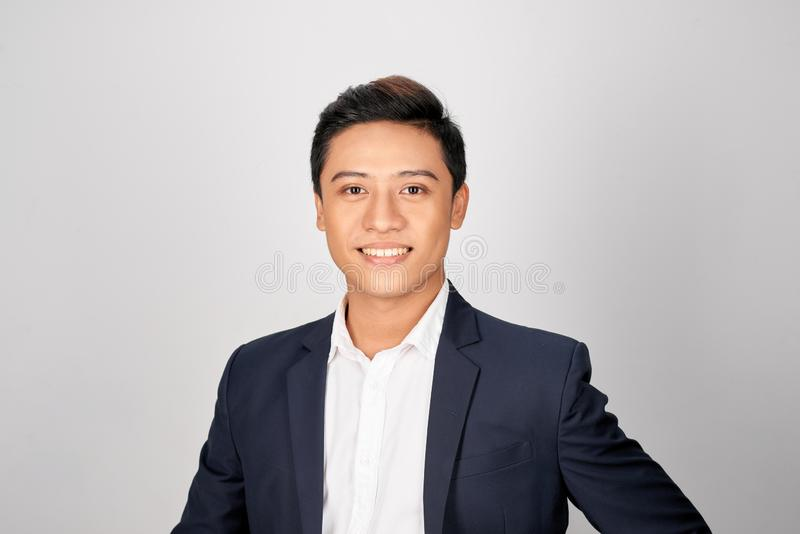 Young good looking asian business man on a white background isolated stock images