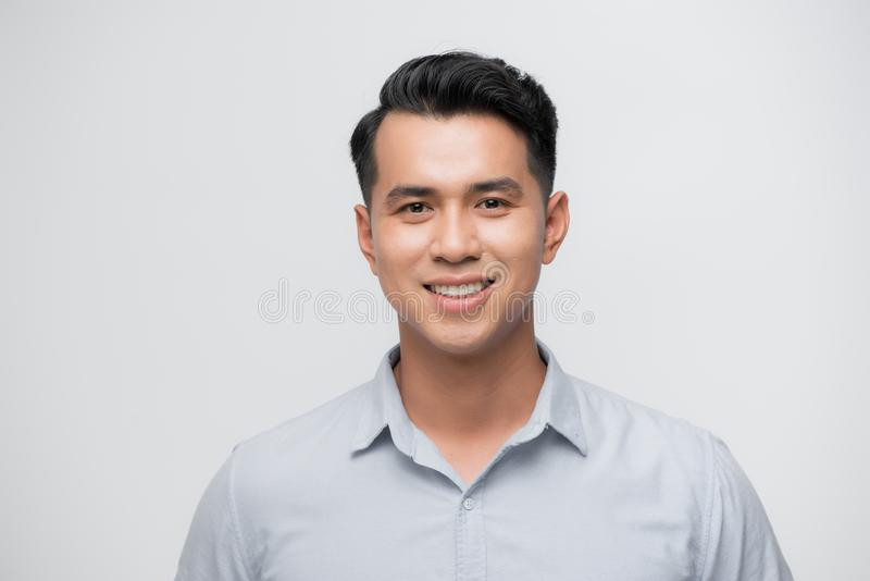 Young good looking asian business man on a white background isolated.  royalty free stock photo