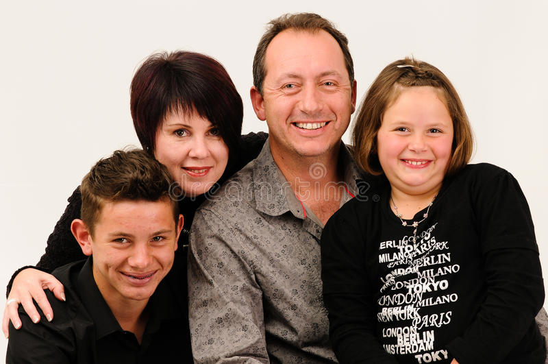 A young good looking family with teenage children royalty free stock photography