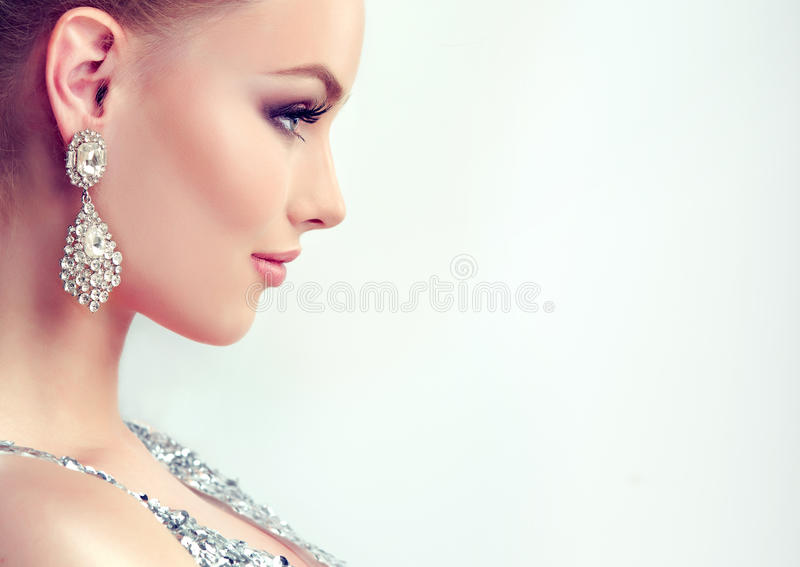 Young gorgeous girl dressed in evening gown and delicate makeup on. Portrait of young gorgeous girl dressed in evening gown,with delicate makeup on her face and royalty free stock image