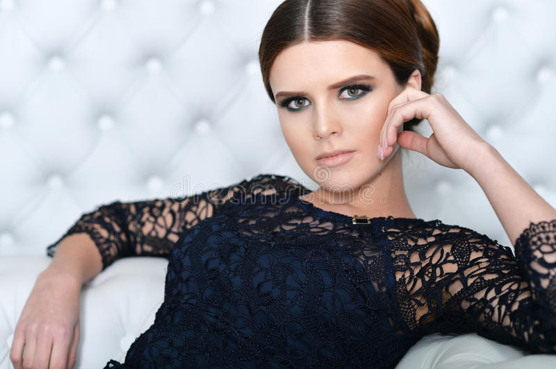 Young gorgeous woman in black dress. With beautiful make-up and hairdo stock photos