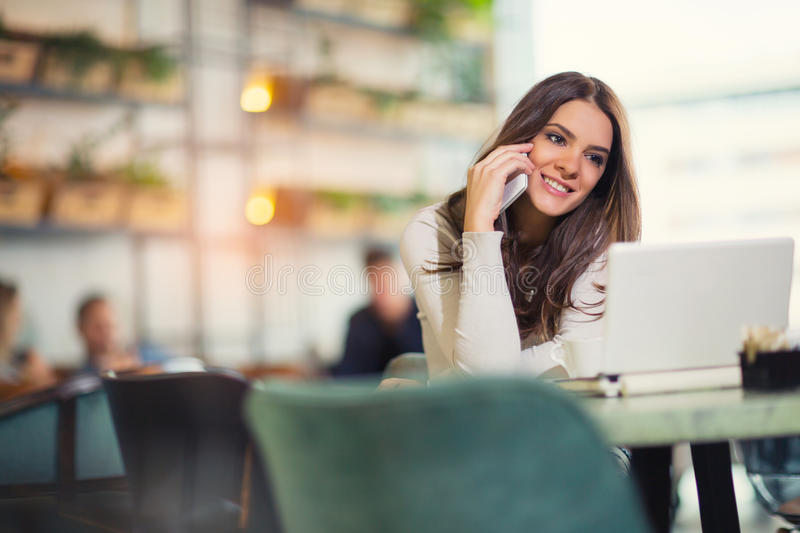 Young gorgeous woman having smart phone conversation stock photo