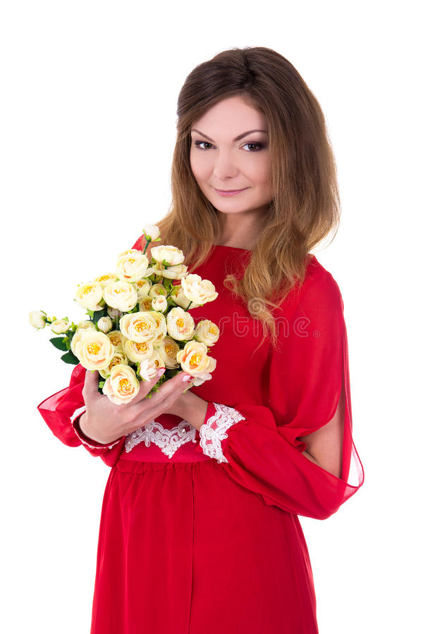 Young gorgeous woman in red dress with flowers on white stock image