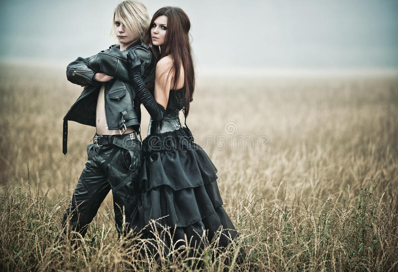 Young goth couple portrait. Young goth couple outdoors portrait royalty free stock photo