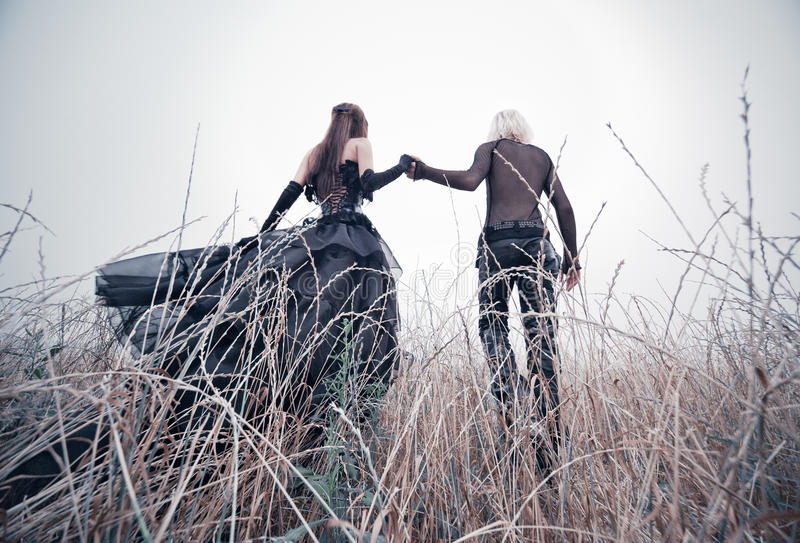 Download Young Goth Couple Walking On Field Stock Image - Image: 15851631