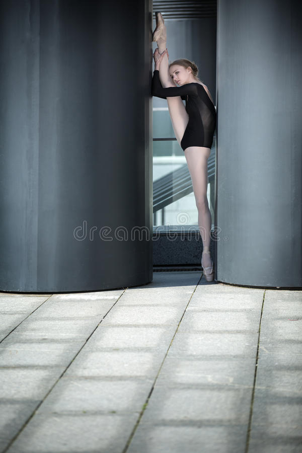 Young graceful ballerina in black bathing suit on stock image