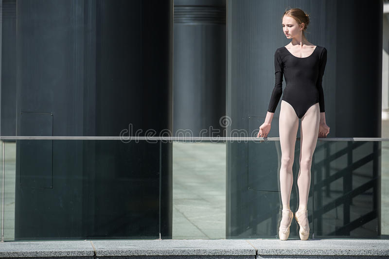 Young graceful ballerina in black bathing suit on royalty free stock photo