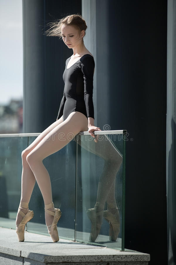 Young graceful ballerina in black bathing suit on stock photos