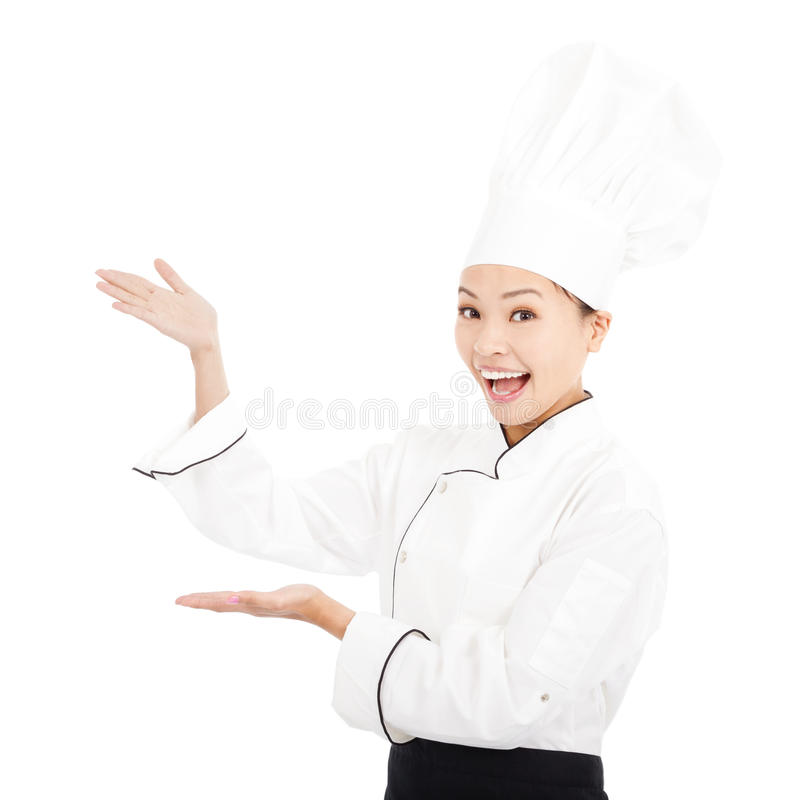 Young graceful woman dressed as a cook with cap. On white background royalty free stock photos
