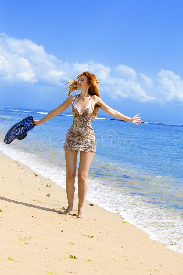 Young Graceful Woman Goes On Coast Of Ocean With S Stock Images