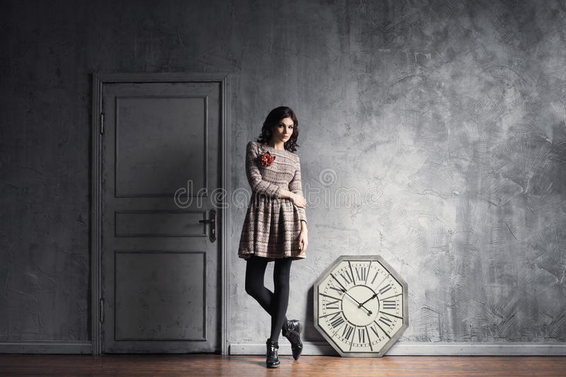 Young and graceful woman posing in an ancient interior stock images