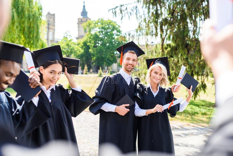 young graduated students spending time together stock photo