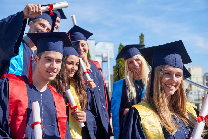 Young graduates students group royalty free stock photo