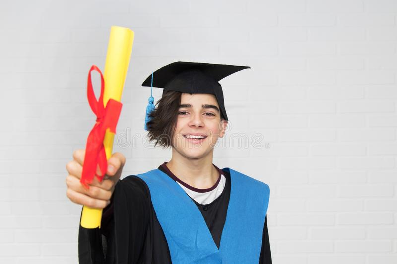 Young  in a graduation. Suit stock photography
