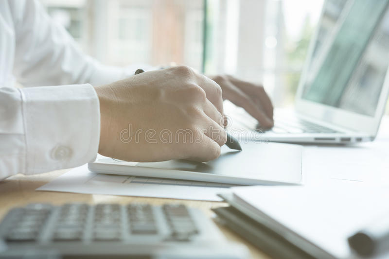 Young graphic designer working with computer. creative man using stock photos