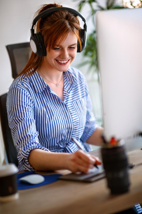 Young graphic designer working at desk royalty free stock image