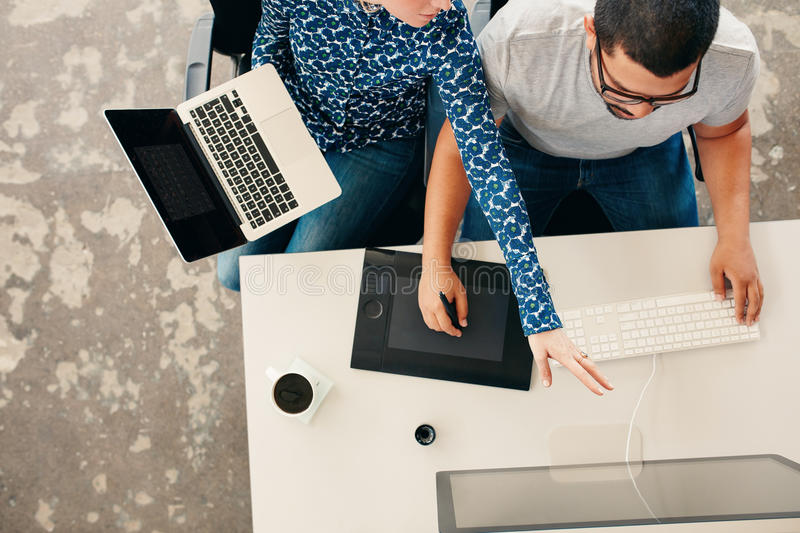 Young graphic designers coworking in office royalty free stock images