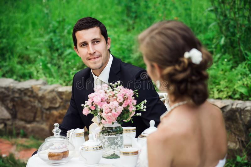 Young groom looking delighted at his bride royalty free stock photos