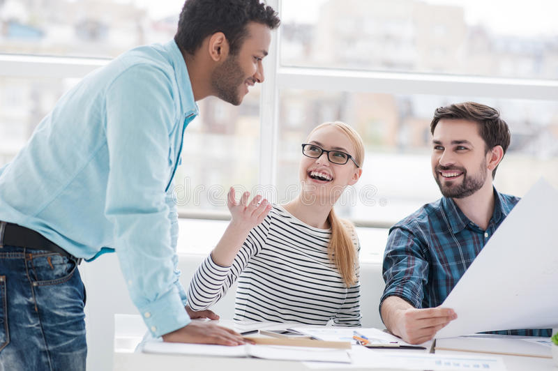 Young group of architects discussing business plans royalty free stock photography