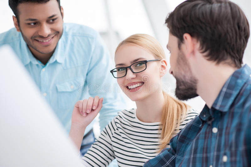 Young group of architects discussing business plans royalty free stock photos