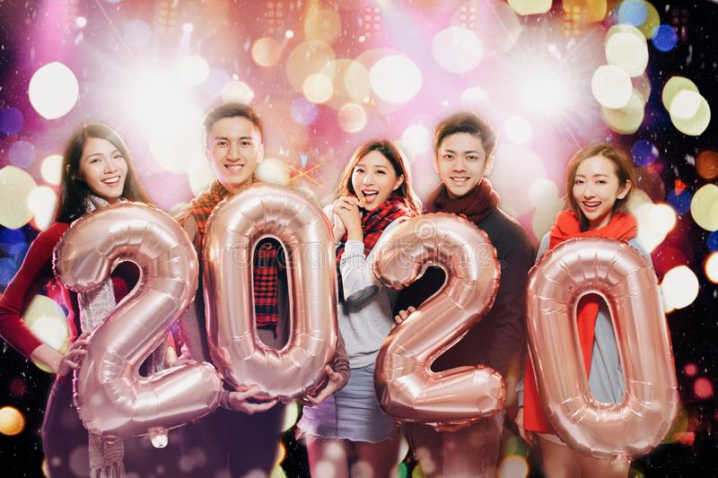 Young group celebrating new year 2020 party stock image