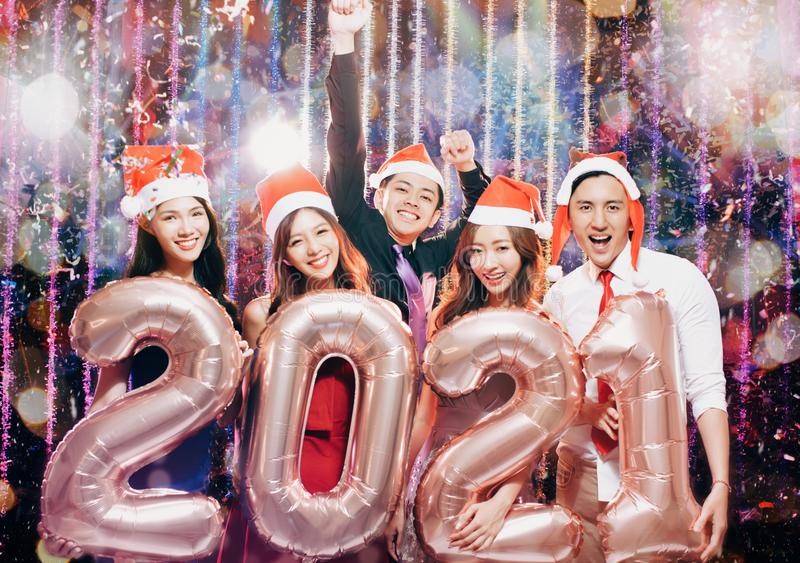 Young group celebrating new yew 2021 in christmas royalty free stock photo