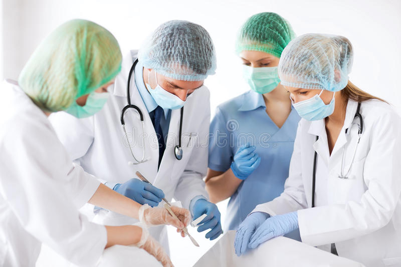 Download Young Group Of Doctors Doing Operation Stock Image - Image: 33508535