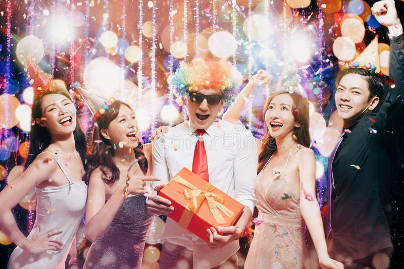 Young group enjoy birthday party in night club royalty free stock photography