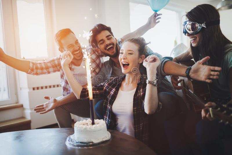 Young group of happy friends celebrating birthday. With cake royalty free stock photos